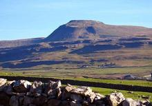 Ingleborough rising at 2,372 feet above sea level